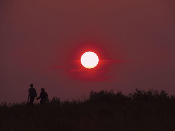 Couple walking during sunset